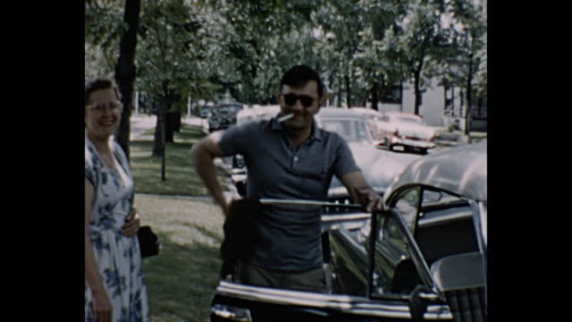 1960s Home Movie - Man cleaning his classic car
