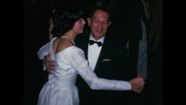 vídeos de stock e filmes b-roll de 1960s home movie wedding / bride dances with father and other relatives - casamento