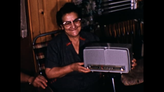 1960s home movie - woman receives radio as gift - radio stock videos & royalty-free footage