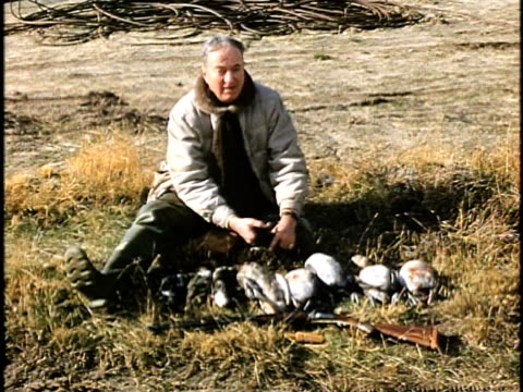 1960s ws hunter with dead ducks, lebec, california, usa - 鳥を狩る点の映像素材/bロール