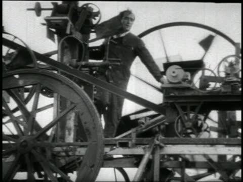 vídeos y material grabado en eventos de stock de b/w 1960s inventor jean tinguely standing on large spinning contraption / newsreel - invento