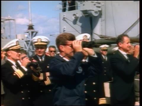 1960s john kennedy + naval officers on ship looking thru binoculars / newsreel - john f. kennedy myndighetsroll bildbanksvideor och videomaterial från bakom kulisserna