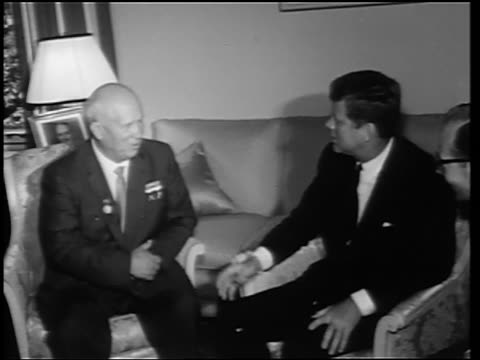 B/W 1960s John Kennedy Nikita Khrushchev sitting in chairs talking / Germany / newsreel