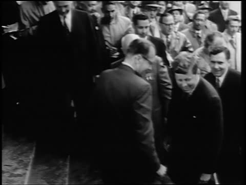 B/W 1960s John Kennedy Nikita Khrushchev walking up stairs surrounded by crowd / Germany