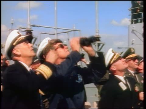 1960s john kennedy with binoculars + naval officers looking up watching missile launch - john f. kennedy myndighetsroll bildbanksvideor och videomaterial från bakom kulisserna