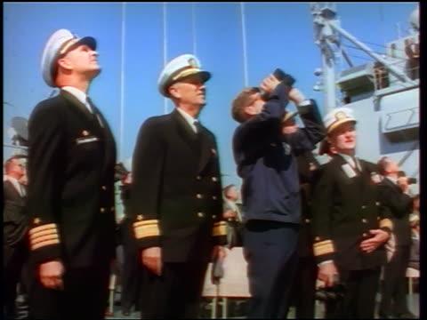 1960s john kennedy with binoculars + naval officers looking up watching missiles / newsreel - john f. kennedy myndighetsroll bildbanksvideor och videomaterial från bakom kulisserna