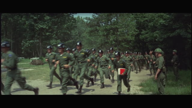 1960s ws large group of soldiers marching at training camp - militärisches trainingslager stock-videos und b-roll-filmmaterial