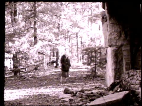 lillian smith walking outdoors through forest, walking toward countryside home, entering house. clayton, georgia, ga, laurel falls camp, blue ridge... - appalachia bildbanksvideor och videomaterial från bakom kulisserna