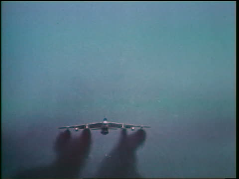 1960s low angle b47 bomber flying over camera in blue sky / cold war / documentary - military aeroplane stock videos & royalty-free footage