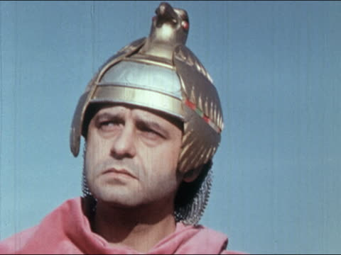 1960s low angle close up reenactment roman soldier wearing metal bird-shaped helmet glancing from side to side - roman soldier stock videos and b-roll footage
