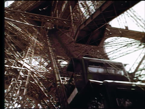 1960s low angle from middle of eiffel tower elevator ascending / paris, france - eiffel tower paris stock videos & royalty-free footage