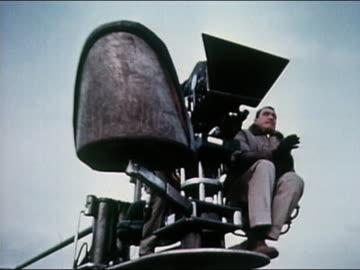 1960s low angle medium shot director on crane shooting a film / los angeles, california - film camera stock videos & royalty-free footage