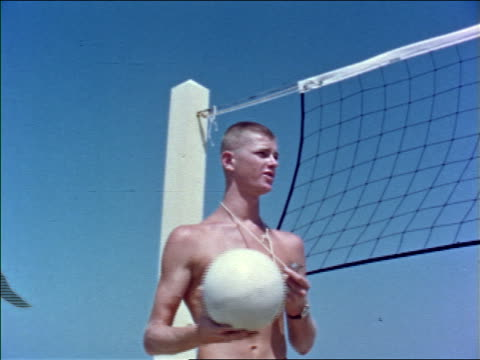1960s low angle shirtless man with whistle talking then throwing volleyball near net outdoors / educational - shirtless stock videos & royalty-free footage