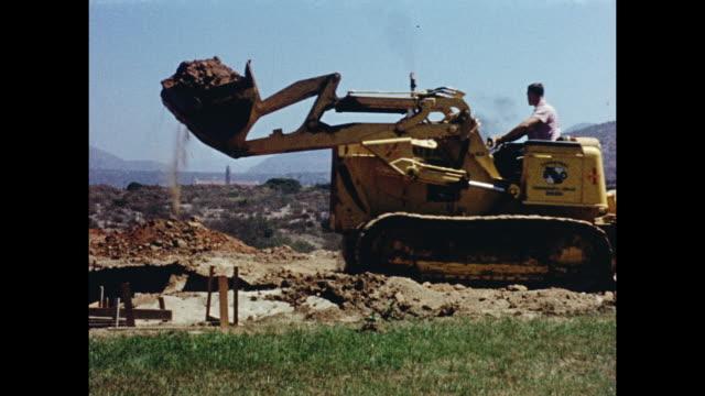 1960s man operating bulldozer - bulldozer stock-videos und b-roll-filmmaterial