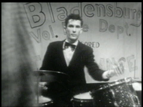 b/w 1960s man playing drums in rock band at high school dance - rock musician stock videos & royalty-free footage