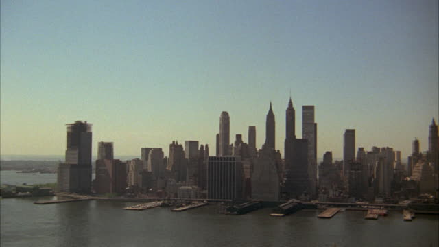 1960s ws ha pan manhattan skyline across east river / new york city, usa - 1968 stock videos & royalty-free footage