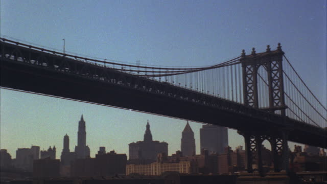 1960s ws la pan manhattan skyline with manhattan bridge in foreground / new york city, usa - manhattan bridge stock videos and b-roll footage