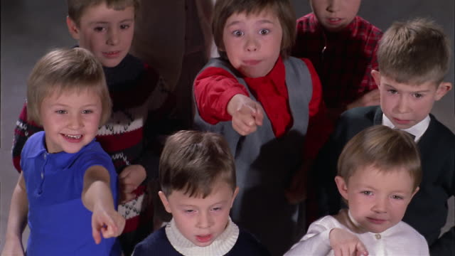 1960s medium shot children watching puppet show, pointing and laughing - indicare video stock e b–roll