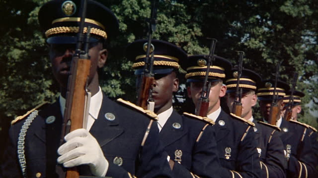 1960s medium shot row of soldiers moving into firing position and back to attention / Arlington, VA