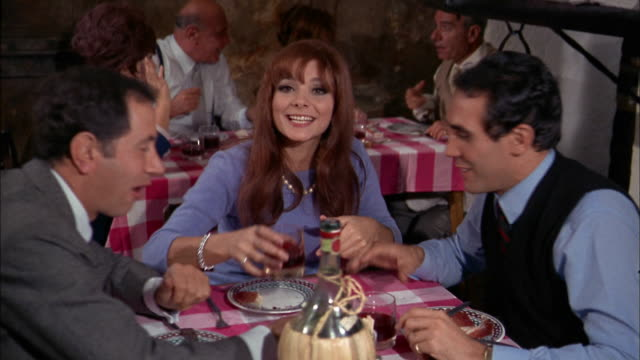 1960s medium shot zoom in people at table drinking wine in restaurant and  toasting cam / italy - italian culture stock videos & royalty-free footage