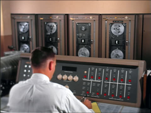 1960s men working in computer room - mainframe stock videos & royalty-free footage