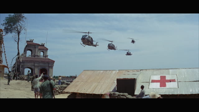 1960s ws la military helicopters flying low over army camp - red cross stock videos & royalty-free footage
