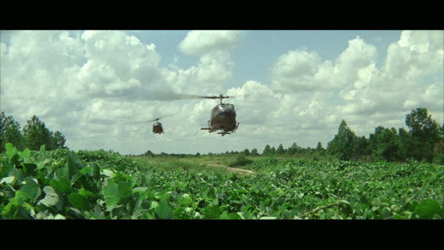 1960s WS Military helicopters landing in field, soldiers boarding