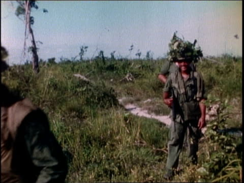 1960s montage a company of soldiers patrolling / vietnam - autorità video stock e b–roll