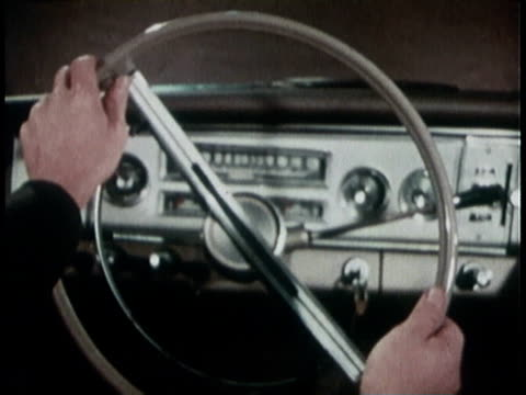 1960s MONTAGE A driver demonstrating the correct turning of a M151A1 Jeep steering wheel
