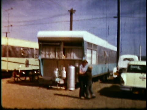 1960s montage adolescent boys rough housing in trailer park / california, usa - camper van stock videos and b-roll footage