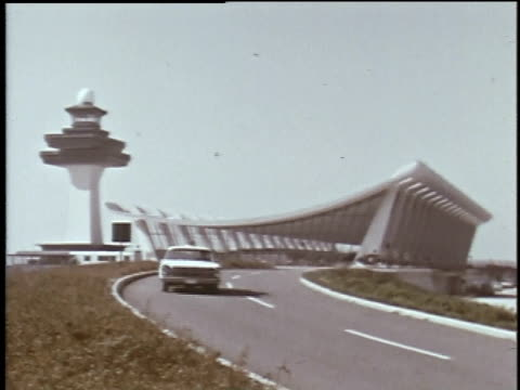 1960s montage airplane landing at dulles airport / dulles, virginia, united states - torre di controllo video stock e b–roll