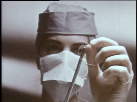 1960s montage doctor performing surgery at va hospital / houston, texas, united states - operation stock videos & royalty-free footage