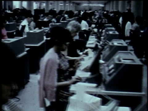 1960s montage employees busy working at the social security administration office / baltimore, maryland, united states - sozialversicherung stock-videos und b-roll-filmmaterial