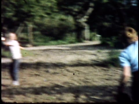 1960s montage family playing baseball / california, usa - wrench stock videos and b-roll footage
