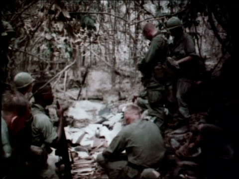 1960s montage first infantry division soldiers examining captured enemy communication equipment including soviet hammerandsickle flag / vietnam - sickle stock videos & royalty-free footage