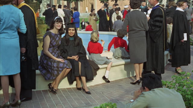 1960s montage graduates and friends walking around campus - 1968 stock videos and b-roll footage