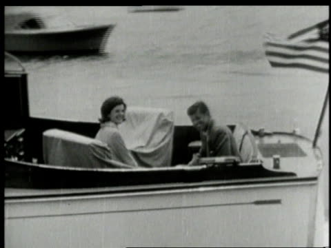 1960s montage john f kennedy and jackie sailing on yacht waving / hyannis port barnstable massachusetts united states - jackie kennedy stock-videos und b-roll-filmmaterial