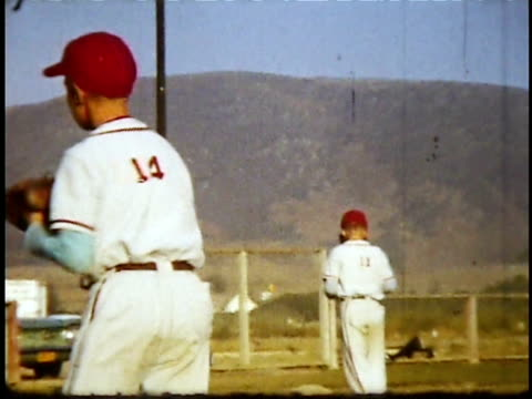 1960s MONTAGE Little league baseball game / Lompoc, California, USA