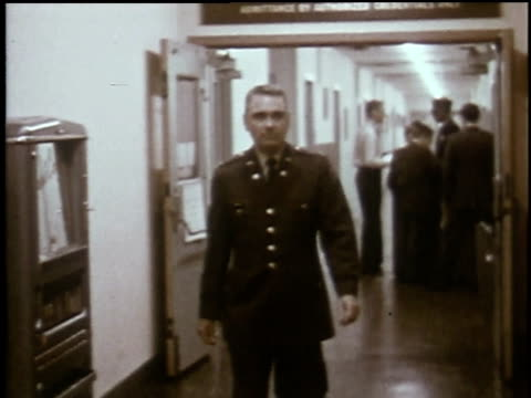 1960s MONTAGE Man walking through hallway in Joint Chiefs of Staff headquarters / Arlington County, Virginia, United States