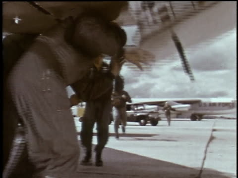 1960s montage men running toward airplane and taking off at air force base in emergency test / plattsburgh, new york, united states - notfallplan konzepte stock-videos und b-roll-filmmaterial