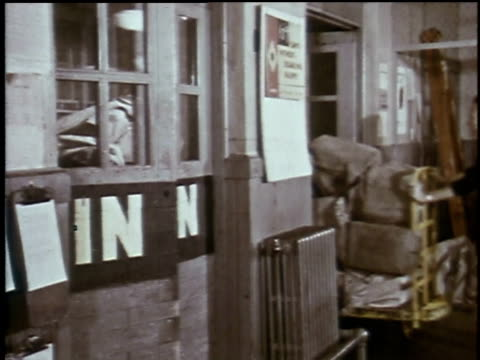 1960s montage postal employees sorting mail / waterloo, iowa, united states - female with group of males stock videos & royalty-free footage