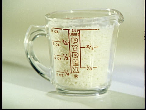 1960s MONTAGE CU Pyrex measuring cup with various amounts of rice and water