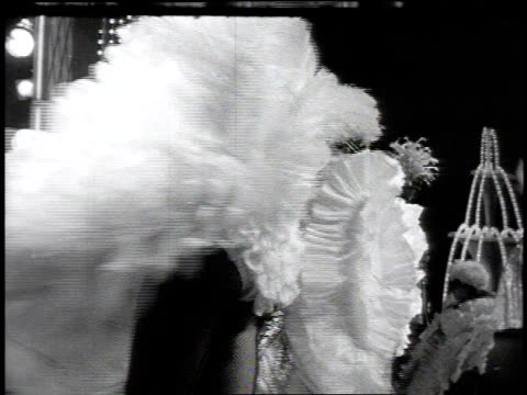 1960s MONTAGE Showgirls performing the can-can at the Tropicana / Las Vegas, Nevada, United States