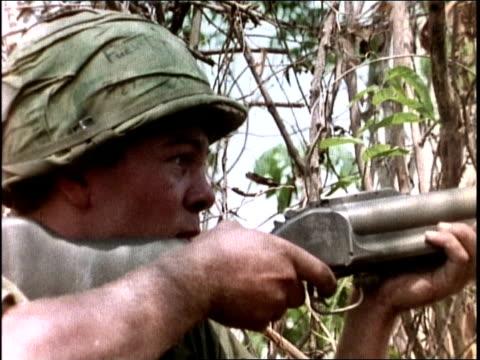 1960s montage soldiers firing rifles and machine guns / vietnam - mitragliatrice video stock e b–roll