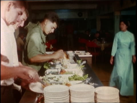 1960s montage soldiers in civilian clothing filling their plates and eating in a local restaurant / vietnam - canteen stock videos & royalty-free footage