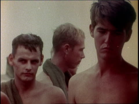 1960s montage soldiers waiting in chow line while eggs are being cooked / vietnam - inquadratura dall'alto di un tavolo video stock e b–roll