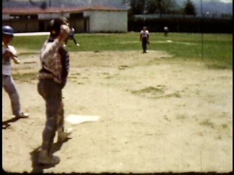1960s montage teenage boys playing baseball / lompoc, california, usa - film montage stock videos & royalty-free footage