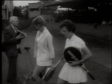 1960s montage tennis match between margaret smith and billie jean moffitt king at wimbledon / london united kingdom united kingdom - billie jean king stock videos & royalty-free footage