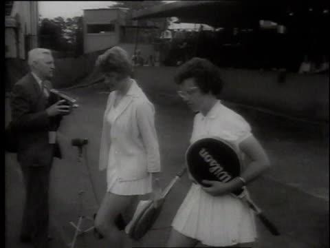 1960s montage tennis match between margaret smith and billie jean moffitt king at wimbledon / london, united kingdom, united kingdom - ビリー・ジーン・キング点の映像素材/bロール