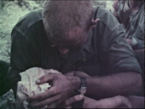 1960s montage us army medics caring for casualties, civilians and soldiers / vietnam - マッシュポテト点の映像素材/bロール